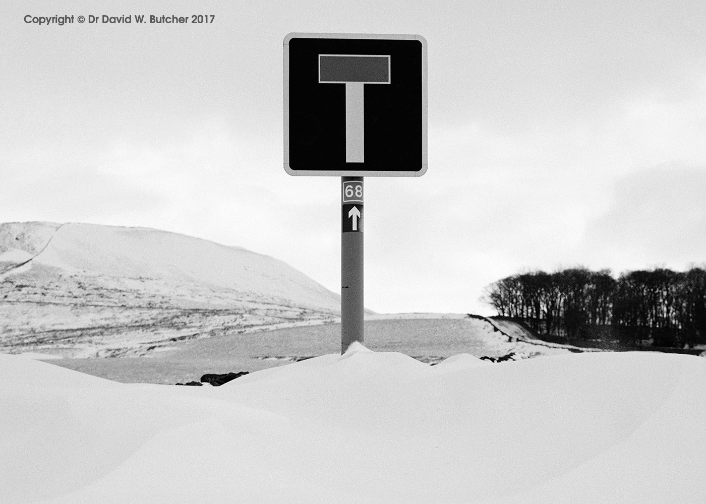 Snow covered road sign near Buxton, Peak District